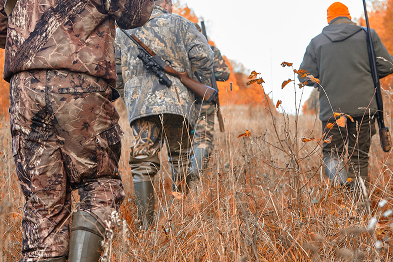 Group of Wisconsin hunters walking through fields during hunting season