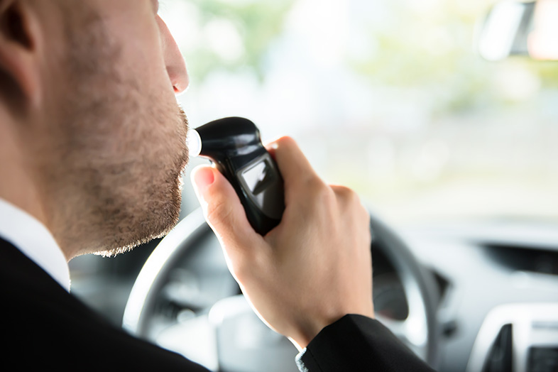Wisconsin man testing his blood alcohol level before driving
