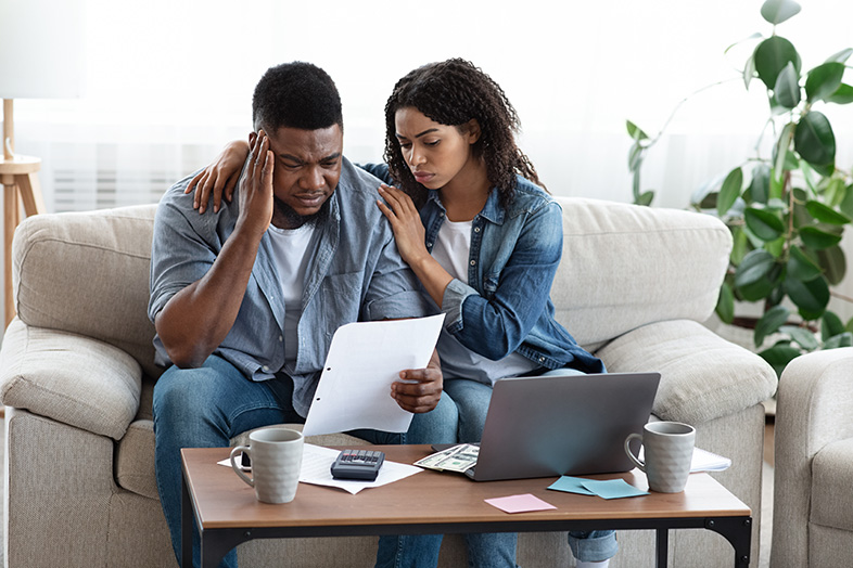 Couple consoling each other after filing Chapter 7 bankruptcy