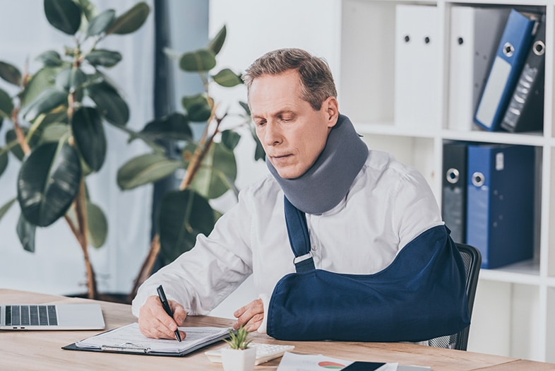 Car accident victim documenting his medical costs and accident injuries for his personal injury lawyer