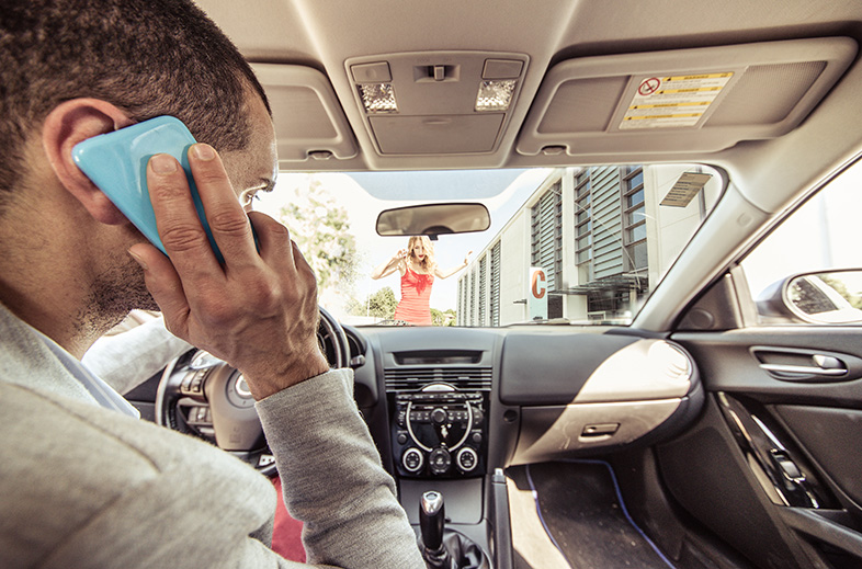 Distracted driver on the phone about to hit a pedestrian