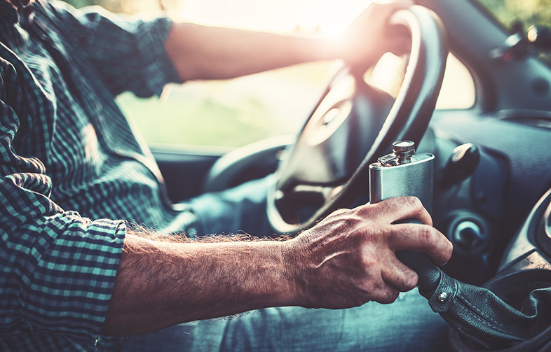 Wisconsin man drinking alcohol from a flask while driving