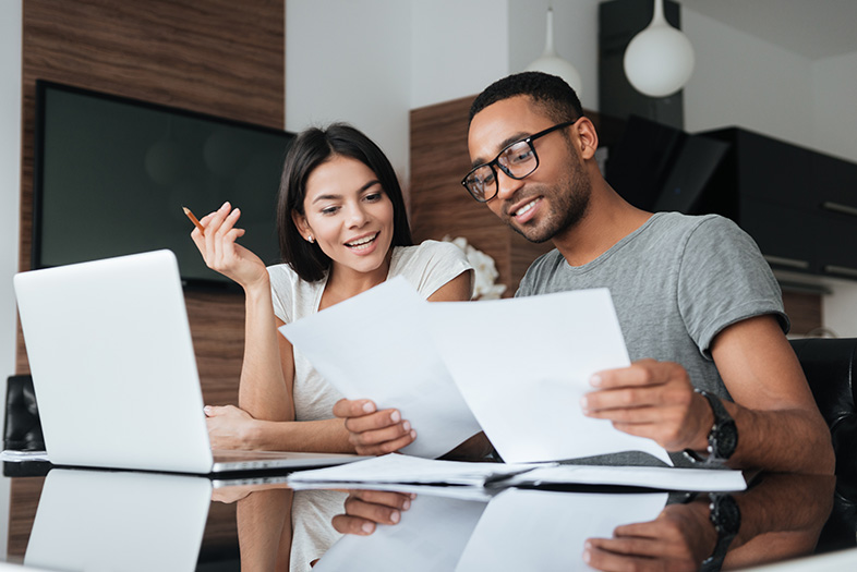 Young couple looking into the benefits and responsibilities of filing bankruptcy